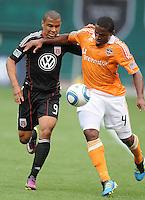 Houston Dynamo defender Jermaine Taylor (4) shields the ball against DC United forward Charlie Davies (9)   Houston Dynamo tied DC United 2-2, at RFK Stadium, Saturday June 25, 2011.