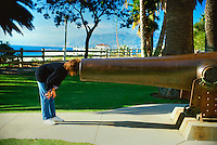 Woman looking into a Giant Canon Barrel