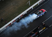 Jan. 21, 2012; Jupiter, FL, USA: Aerial view of NHRA funny car driver Bob Tasca III during testing at the PRO Winter Warmup at Palm Beach International Raceway. Mandatory Credit: Mark J. Rebilas-