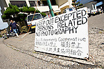 A sign informs visitors of restricted entry into the port area, where meat from dolphins caught during the town's annual slaughter is processed and packaged for market, in Taiji, Japan on 10 September 2009. The dolphin culls have been conducted in near-secrecy since 2003, when members of marine conservation group Sea Shepherd released several dolphins that were being kept in an enclosure ready to be slaughtered..Photographer: Robert Gilhooly