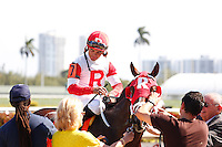 HALLANDALE BEACH, FL - FEBRUARY 04: Jockey Luis Saez after Kitten's Cat wins the Kitten's Joy Stakes at Gulfstream Park. (Photo by Arron Haggart/Eclipse Sportswire/Getty Images)