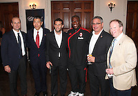 Umberto Gandini and Clarence Seedorf of AC Milan pose with Will Chang, Ben Olsen, Dave Kasper and Kevin Payne of DC United at a reception for AC Milan at DAR Constitution Hall in Washington DC on May 24 2010.
