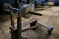 A homemade barbell bench, assembled from wooden planks, an iron pipe and concrete blocks, is seen in the soldiers' dormitory of a military base in the jungle of Darien gap, Panama, 28 January 2015.