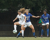 Boston College defender McKenzie Meehan (22) attempts to control the ball as Duke University defender Malinda Allen (22) defends.Boston College (white) defeated Duke University (blue/white), 4-1, at Newton Campus Field, on October 6, 2013.