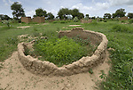 Remains of an African village destroyed in 2003 during an attack by militias that killed 37 people and drove the terrorized survivors into miserable camps for the displaced.
