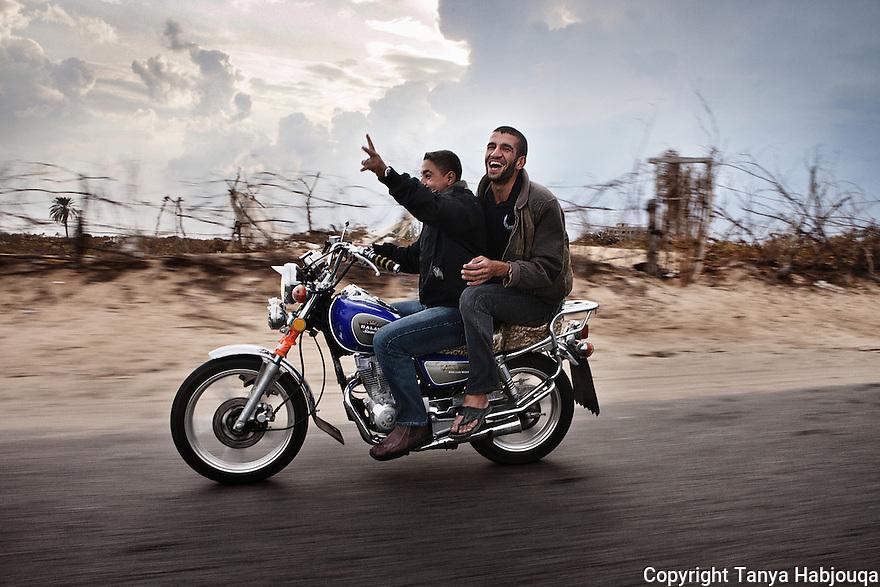 Gazan youth cruise down the back roads of Rafah.