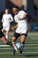 College of St Rose forward Jourdan Thompson (13) works to clear ball.. In 2012 NCAA Division II Women's Soccer Championship Tournament First Round, College of St Rose (white) defeated Wilmington University (black), 3-0, on Ronald J. Abdow Field at American International College on November 9, 2012.