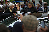 Former president Nelson Mandela waves to supporters after casting his vote at the Killarney Country Club in Houghton, Johannesburg on the day of the 2009 general election.