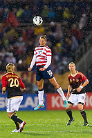 Carli Lloyd (10) of the United States (USA) heads the ball. The United States (USA) and Germany (GER) played to a 2-2 tie during an international friendly at Rentschler Field in East Hartford, CT, on October 23, 2012.