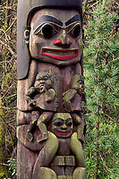 Smiling faces of totem pole Variety's Children by F. Horne, Stanley Park, Vancouver, BC.