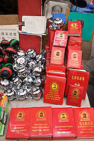 Chairman Mao's Little Red Book and bicycle bells for sale on market stall in Moslem district of Xian, China