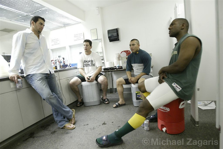 OAKLAND, CA - OCT 5:  Miguel Tejada talks with Eric Chavez, Erubiel Durazo and Ricardo Rincon in the clubhouse after the game  at the Network Assoc. Coliseum on Oct 5, 2003 in Oakland, Calif. The Red Sox defeated Oakland 3-1. ..(Photo by Michael Zagaris/MLB Photos)