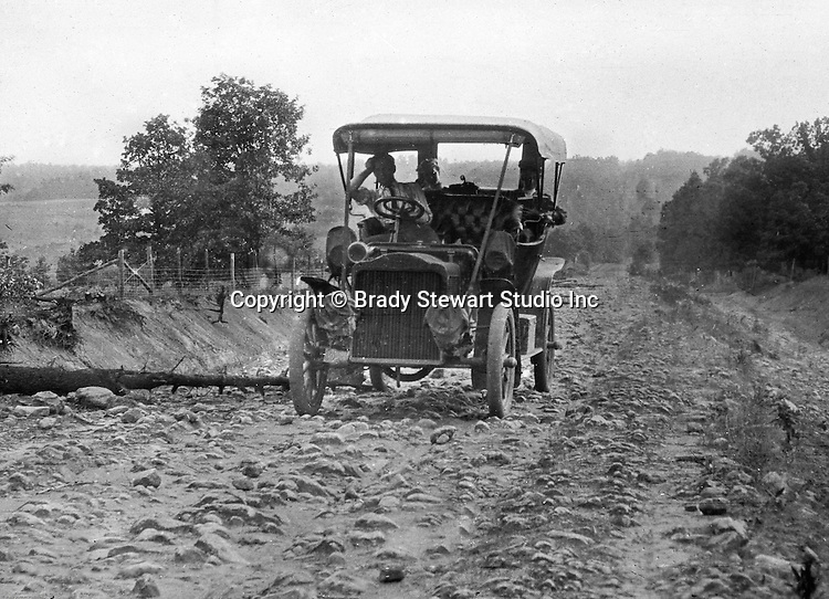 Greensburg PA:  The 1906 Buick Model F broken down after running over a tree on a rocky road outside Greensburg PA - 1906.