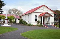 Maori Meeting House, Te Tiriti o Waitangi, erected 1964, Paihia, north island, New Zealand.  The monument on the left commemorates the signing of the Treaty of Waitangi in 1840.