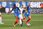 CHESTER, PA - MARCH 01: Grace Geyoro (FRA) (20) clears the ball away from Jade Moore (ENG) (8). The England Women's National Team played the France Women's National Team as part of the She Believes Cup on March, 1, 2017, at Talen Engery Stadium in Chester, PA. The France won the game 2-1.