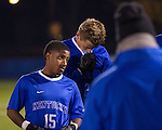 (Left to Right) Caleb Richardson and Kristoffer Tollefsen appear despondent as they huddle up with the team after the tough 1-0 loss to Xavier Thursday evening.