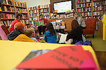 SFMOMA Education Associate for Family Programs reads books about art during a Family Art Day at Linden Tree Books in Los Altos.