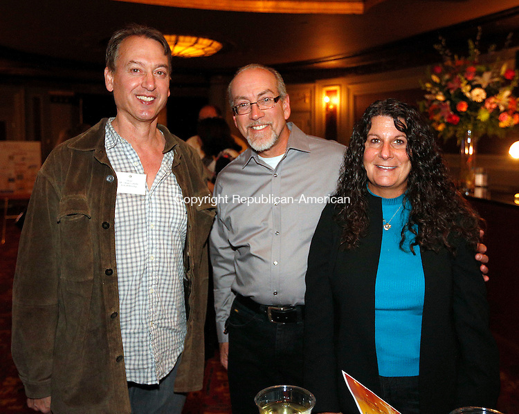 Waterbury, CT- 09 April 2015-040915CM18-  Social moments--- From left, Steve Collete, a volunteer with Acts 4 Ministry and Scott and Mara Little from The Print Shop of Wolcot, are photographed during Acts 4 Ministry's fundraising reception on Thursday, April 9, 2015 at the Palace Theater in Waterbury.  Christopher Massa Republican-American
