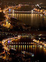 """The combination photo taken on March 26, 2011 shows the Chain Bridge before (Top) and during the """"Earth Hour"""" in Budapest, Hungary. The """"Earth Hour"""", initiated by the World Wild Fund for Nature (WWF) in 2007, calls on families and buildings to turn off the lights for one hour on the last Saturday night of March. ATTILA VOLGYI"""