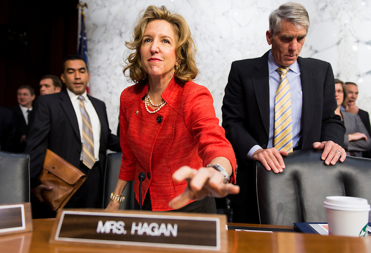 UNITED STATES - SEPTEMBER 16: Sen. Kay Hagan, D-N.C., and Sen. Mark Udall, D-Colo., take their seats for the Senate Armed Services Committee hearing on U.S. policy towards Iraq and Syria and the threat posed by the Islamic State of Iraq and the Levant (ISIL) on Tuesday, Sept. 16, 2014. (Photo By Bill Clark/CQ Roll Call)