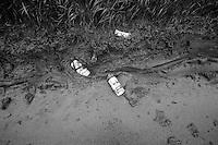 Dwars Door Vlaanderen 2013.after the serious crash down Ladeuze some bidons remain in the mud