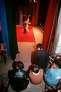 April 15th, 1989, Poyang, Jiangxi Province, China. Backstage during the performance of traveling opera troupe. While the actors perform, their words are projected on transcarencies visible to the audience so that local people can also read the play.