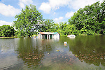 8/11/11} Vicksburg} -- Vicksburg, MS, U.S.A A house on Chicksaw road in the North Kings Community is filling with water from the Mississippi River  May 11,2011. Vicksburg a riverfront town steeped in war and sacrifice, gets set to battle an age-old companion: the Mississippi River. The city that fell to Ulysses S. Grant and the Union Army after a painful siege in 1863 is marshalling a modern flood-control arsenal to keep the swollen Mississippi from overwhelming its defenses. PHOTO©SUZIALTMAN.COM.Photo by Suzi Altman, Freelance.