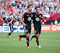 Chris Pontius (13) of D.C. United celebrates converting his penalty kick with teammate John Thorrington (8) during a Major League Soccer game at RFK Stadium in Washington, DC.  D.C. United defeated San Jose Earthquakes, 1-0.