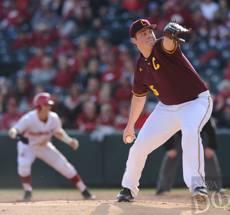 NWA Democrat-Gazette/ANDY SHUPE<br />Central Michigan starter Sean Renzi delivers a pitch Friday, Feb. 19, 2016, as Eric Cole of Arkansas leads off of first base during the first inning at Baum Stadium in Fayetteville. Visit nwadg.com/photos to see more photographs from the game.