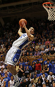 Freshman Austin Rivers does a 360-degree turn in the air during the dunk contest. Photo by Al Drago...