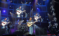 Dave Mathews sings to his hometown Friday at the John Paul Jones Arena in Charlottesville, Va.
