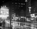 Pittsburgh PA:  View south on Sixth Street toward Liberty Avenue - 1951. Local businesses include; Harris Theatre, BK Elliott Company, Dines Bar, Leo's Flowers, Richest Restaurant, Thompson's Cafeteria and Yung Toy Restaurant.