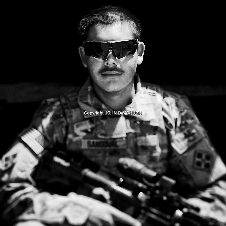 PFC Sandoval from 1 Platoon, Delta Co, 1-66, 4th Infantry Division, is seen at Combat Outpost TJ in the Arghandab Valley, Kandahar, 03 May 2011. (John D McHugh)
