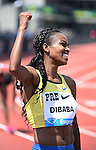 Genzebe Dibaba of Ethiopia celebrates after winning the Women's 5000 meter run on the final day of the Prefontaine Classic at Hayward Field in Eugene, Oregon, USA, 30 MAY 2015. (EPA photo by Steve Dykes)