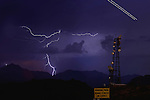 Aug. 21, 2012; Phoenix, AZ, USA: lightning bolt storm monsoon cloud thunderstorm airplane night antenna South Mountain Mandatory Credit: Mark J. Rebilas