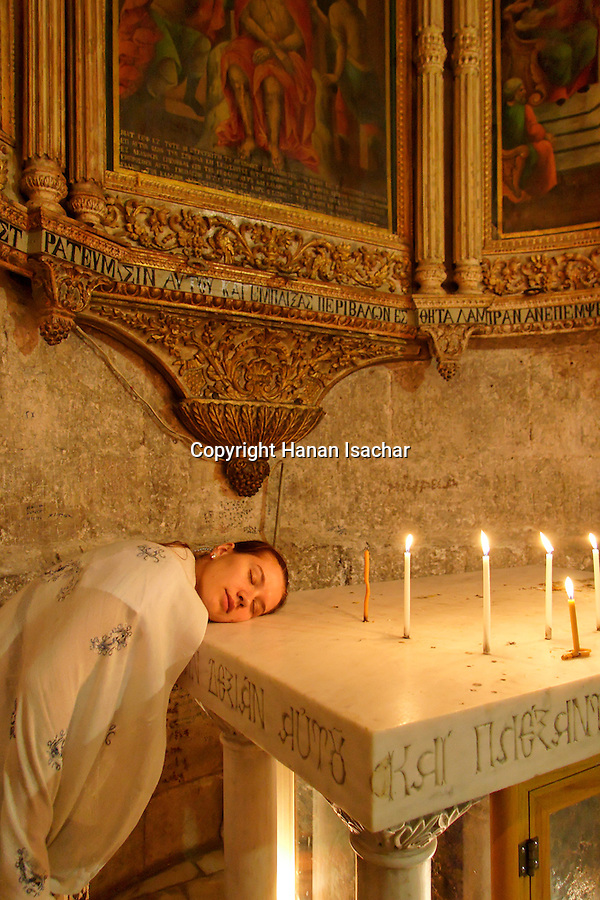 Israel, Jerusalem Old City. A pilgrim at the Chapel of Derision at the Church of the Holy Sepulchre recalling the time when Christ was mocked by the soldiers who executed him 2006<br />