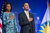 United States President Barack Obama and First Lady Michelle Obama listen to the national anthem at the groundbreaking ceremony of the Smithsonian National Museum of African American History and Culture in Washington, D.C. on Wednesday, February 22, 2012. The museum is scheduled to open in 2015 and will be the only national museum devoted exclusively to the documentation of African American life, art, history and culture. .Credit: Andrew Harrer / Pool via CNP