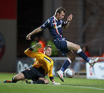 Colin McMenamin goes past Dundee Utd keeper Radoslaw Cierzniak but pulls his shot wide in fornt of an open goal