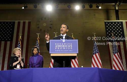 Philadelphia, PA - January 17, 2009 -- United States President-elect Barack Obama delivers remarks during a rally to kickoff his Whistle Stop Train Tour in Philadelphia on Saturday, January 17, 2009. The ceremonial trip will carry President-elect Obama, Vice President-elect Biden and their families to Washington for their inaugurations with additional events in Philadelphia, Wilmington and Baltimore. Obama, who will be sworn in as the 44th President of the United States on January 20, 2009, was joined on stage by his wife Michelle (2nd-L) and Patricia Stiles a resident of Parker, Colorado. .Credit: Kevin Dietsch - Pool via CNP