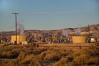 730850359 oil derricks and storage tanks in a working oil field in southern kern county california