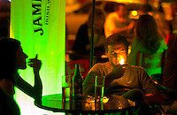 Midnight bar patrons enjoy an after-dinner drink at Moby Dick in Punta del Este, Uruguay. The venerable South American beach resort is having a rennaisance. (Kevin Moloney for the New York Times)