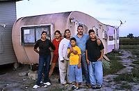 Texas, McAllen, Rio Grande Valley<br /> Mexican immigrants in Colonia pueblo de Palmas. Felipe Macias and his family, from Guadalajara, in front of their trailer home.