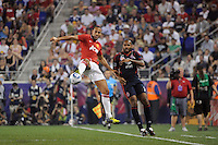 Rio Ferdinand (5) of Manchester United plays the ball in front of Thierry Henry (14) of the MLS All-Stars. Manchester United defeated the MLS All-Stars 4-0 during the MLS ALL-Star game at Red Bull Arena in Harrison, NJ, on July 27, 2011.