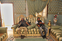 Rebel fighters rest in a room decked out in the style of an ancient regime French grandeura house owned by Muhammad Matuq, Secretary for Public Works under Colonel Gaddafi, and one of the suspects in the killing of British policewoman Yvonne Fletcher outside the Libyan embassy in London in 1984. A rebel convoy raided the house, in the Tripoli suburb of Qasr ben Ghashir, where some of Gaddafi's soldiers had made a base, but on arrival they found the building already abandoned. In February 2011 an armed revolution broke out in Libya and after six months of fighting it appears that Gaddafi's 42 year regime has come to an end while the former dictator is currently on the run.