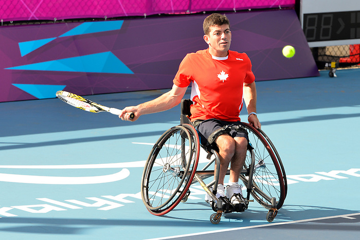 London, England 26/08/2012 - Joel Dembe hits the ball during a training session at the London 2012 Paralympic Games in Eton Manor. (Photo: Phillip MacCallum/Canadian Paralympic Committee)