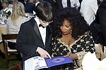 21 May 2005: 13 yr. old jazz pianist Matt Savage goes over lyrics with Chaka Khan at the 2nd Annual Gala Dinner benefiting the Chaka Khan Foundation in Beverly Hills, CA. .Mandatory Credit: Juliann Tallino