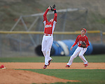 Lafayette Middle School third baseman Hunter Harwell makes a catch for an out as Corey Taylor backs up the play vs. Marshall County in Oxford, Miss. on Thursday, February 28, 2013.