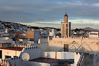 Rooftops of the medina or old town of Tetouan with the minaret of the 18th century Zaouiat Sidi ali Benraisoun or Octagonal Mosque, on the slopes of Jbel Dersa in the Rif Mountains of Northern Morocco. Tetouan was of particular importance in the Islamic period from the 8th century, when it served as the main point of contact between Morocco and Andalusia. After the Reconquest, the town was rebuilt by Andalusian refugees who had been expelled by the Spanish. The medina of Tetouan dates to the 16th century and was declared a UNESCO World Heritage Site in 1997. Picture by Manuel Cohen