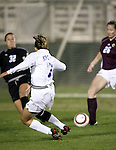 Duke's Darby Kroyer (7) score a goal as her shot beats Boston College's Arianna Criscione (32) and Lindsey McArdle (26) at 4:54 giving Duke a 1-0 lead on Wednesday, November 2nd, 2005 at SAS Stadium in Cary, North Carolina. The Duke University Blue Devils defeated the Boston College Eagles 2-0 during their Atlantic Coast Conference Tournament Quarterfinal game.
