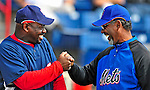4 March 2009: New York Mets' Manager Jerry Manuel (right) catches up with Washington Nationals' first base coach Marquis Grissom prior to a Spring Training game against the Washington Nationals at Space Coast Stadium in Viera, Florida. The Nationals rallied to defeat the Mets 6-4 . Mandatory Photo Credit: Ed Wolfstein Photo